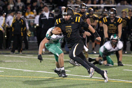 H:EDITORIALPhotos11NOVEMBER2015RG-11-12-15 RG 236 RICHARD GILLARFD/Acorn Newspapers Newbury Park's quarterback Cameron Rising runs the ball on Friday, November 6 during their game against Thousand Oaks. Thousand Oaks won the Conejo Valley Trophy with a field goal in the final minutes of the game, 36-35.