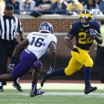 Oct 10, 2015; Ann Arbor, MI, USA; Michigan Wolverines running back Karan Higdon (22) rushes on Northwestern Wildcats safety Godwin Igwebuike (16) in the second quarter at Michigan Stadium. Mandatory Credit: Rick Osentoski-USA TODAY Sports