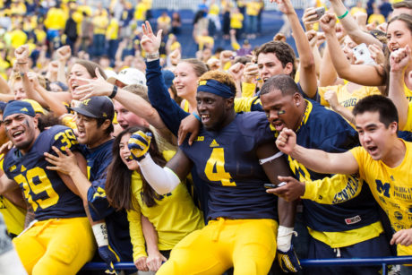 19 September 2015:  Michigan Wolverines FB Sione Houma (39) and Michigan Wolverines DE Reuben Jones (4) celebrate with the fans following the game between the UNLV Rebels and Michigan Wolverines at Michigan Stadium Ann Arbor, MI.  Michigan defeated UNLV 28-7.