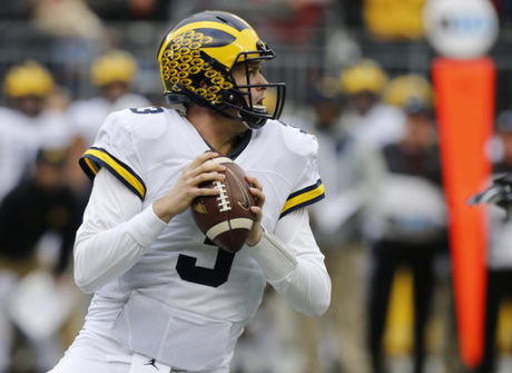 Michigan quarterback Wilton Speight drops back to pass against Ohio State during the first half of an NCAA college football game Saturday, Nov. 26, 2016, in Columbus, Ohio. (AP Photo/Jay LaPrete)